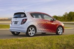 2012 Chevrolet Sonic Hatchback in Victory Red / Summit White - Static Rear Right Three-quarter View
