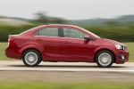 2012 Chevrolet Sonic Sedan in Victory Red - Driving Side View