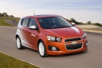 2012 Chevrolet Sonic Hatchback in Victory Red / Summit White - Driving Front Right Three-quarter View