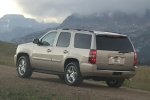 Picture of a 2014 Chevrolet Tahoe LTZ in Champagne Silver Metallic from a rear left three-quarter perspective