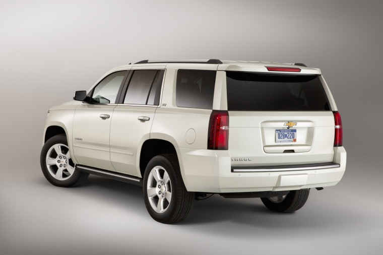 2015 Chevrolet Tahoe in Summit White from a rear left view