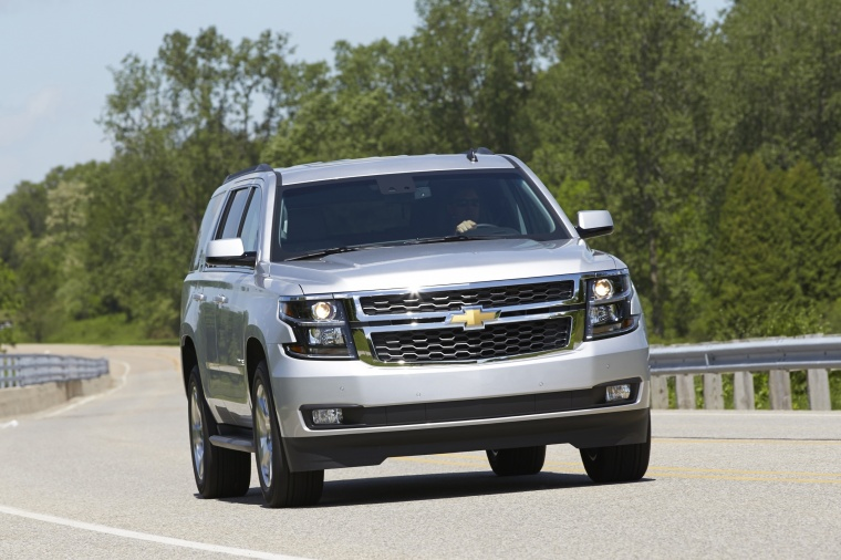 Picture of a driving 2016 Chevrolet Tahoe in Silver Ice Metallic from a front right perspective