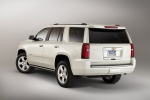 Picture of a 2016 Chevrolet Tahoe in Summit White from a rear left perspective