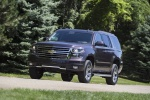 Picture of a driving 2016 Chevrolet Tahoe LT 4WD Z71 in Sable Metallic from a front left three-quarter perspective