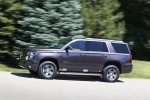 Picture of a driving 2016 Chevrolet Tahoe LT 4WD Z71 in Sable Metallic from a side perspective
