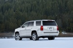 Picture of a 2016 Chevrolet Tahoe in Summit White from a rear left three-quarter perspective