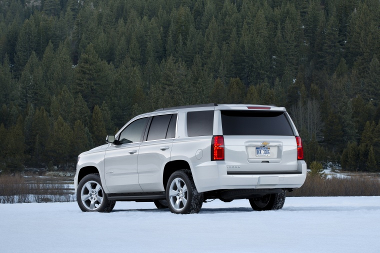 2018 Chevrolet Tahoe in Summit White from a rear left three-quarter view