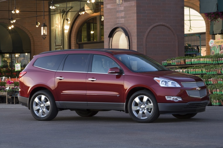 2012 Chevrolet Traverse LTZ in Crystal Red Tintcoat from a front right three-quarter view