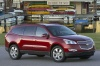 2012 Chevrolet Traverse LTZ in Crystal Red Tintcoat from a front right view