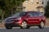 2012 Chevrolet Traverse LTZ in Crystal Red Tintcoat from a front left three-quarter view