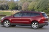 2012 Chevrolet Traverse LTZ in Crystal Red Tintcoat from a rear left three-quarter view