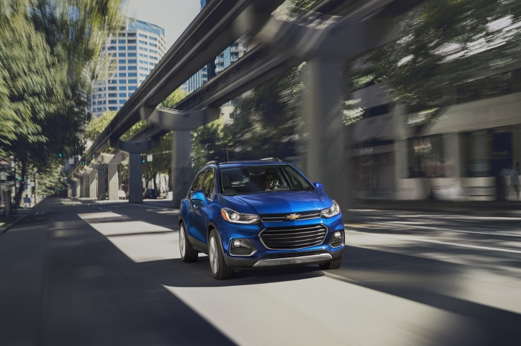 Picture of a driving 2018 Chevrolet Trax Premier in Blue from a front right perspective