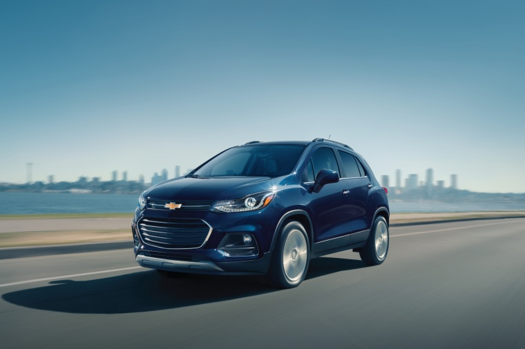 Picture of a driving 2018 Chevrolet Trax Premier in Storm Blue Metallic from a front left three-quarter perspective