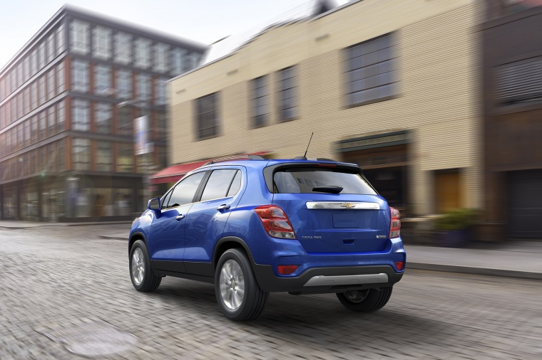 Picture of a driving 2018 Chevrolet Trax Premier in Blue from a rear left perspective