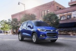 Picture of a driving 2018 Chevrolet Trax Premier in Blue from a front right three-quarter perspective