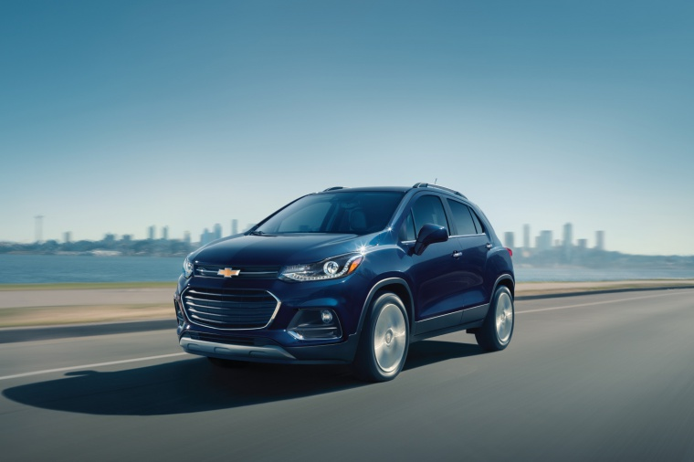 Picture of a driving 2019 Chevrolet Trax Premier in Storm Blue Metallic from a front left three-quarter perspective