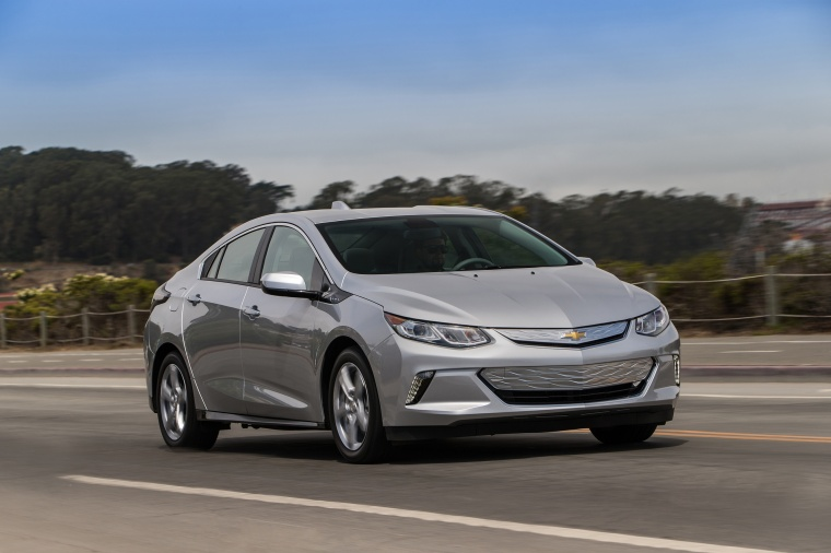 Driving 2017 Chevrolet Volt in Silver Ice Metallic from a front right three-quarter view