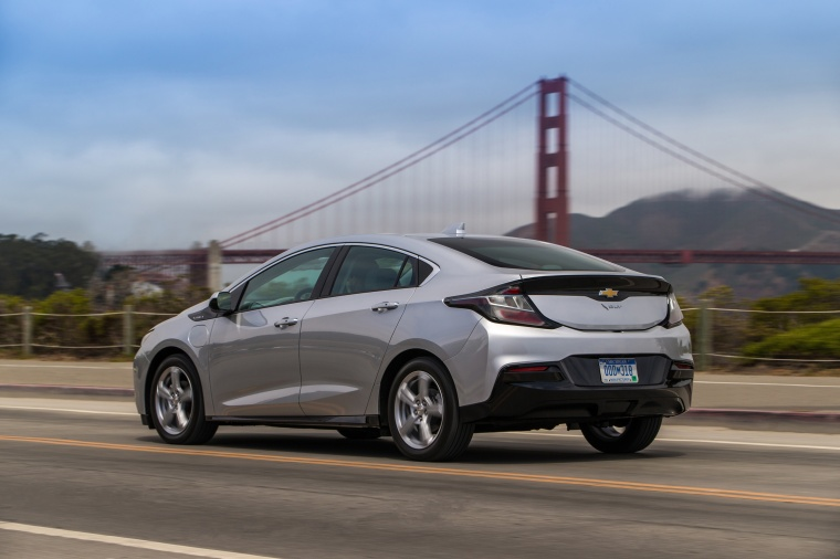 Driving 2017 Chevrolet Volt in Silver Ice Metallic from a rear left three-quarter view