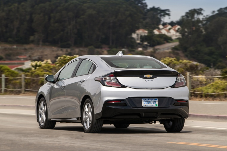 Driving 2017 Chevrolet Volt in Silver Ice Metallic from a rear left view