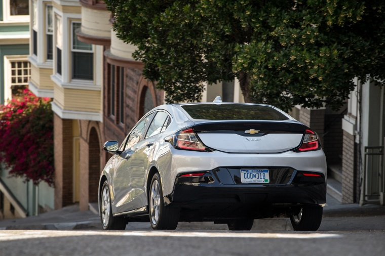 Driving 2017 Chevrolet Volt in Silver Ice Metallic from a rear view