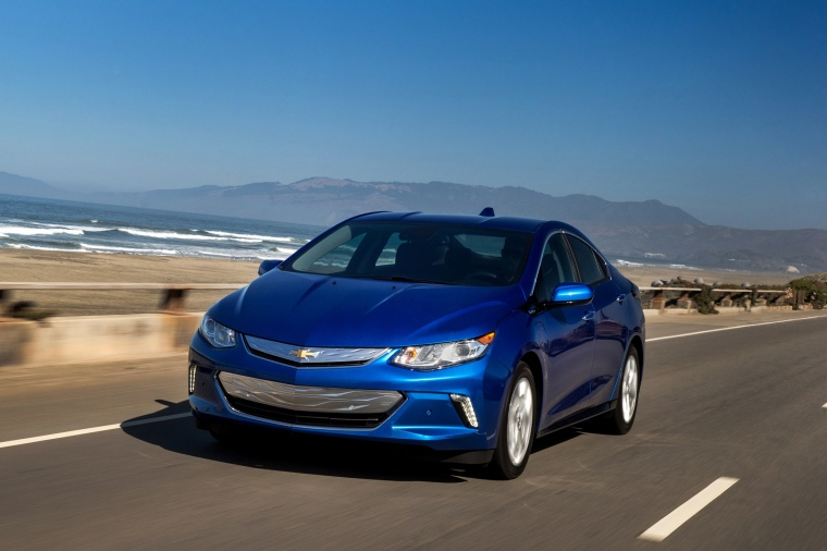 Driving 2017 Chevrolet Volt in Kinetic Blue Metallic from a front left view