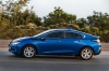 Driving 2017 Chevrolet Volt in Kinetic Blue Metallic from a side view