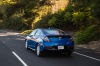 Driving 2017 Chevrolet Volt in Kinetic Blue Metallic from a rear left view