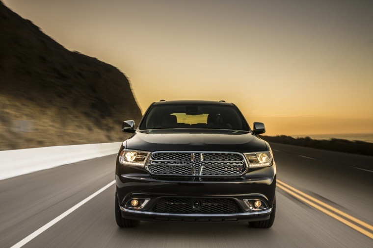 Picture of a driving 2014 Dodge Durango Citadel in Brilliant Black Crystal Pearlcoat from a frontal perspective