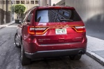 Picture of a 2014 Dodge Durango Limited AWD in Deep Cherry Red Crystal Pearlcoat from a rear left perspective