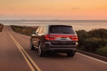 Picture of a driving 2014 Dodge Durango R/T in Maximum Steel Metallic Clearcoat from a rear left perspective