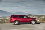 Picture of a driving 2016 Dodge Durango Limited AWD in Deep Cherry Red Crystal Pearlcoat from a right side perspective