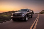 Picture of a driving 2016 Dodge Durango R/T in Maximum Steel Metallic Clearcoat from a front left perspective