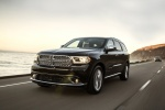 Picture of a driving 2016 Dodge Durango Citadel in Brilliant Black Crystal Pearlcoat from a front left perspective