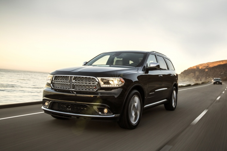 Picture of a driving 2017 Dodge Durango Citadel in Brilliant Black Crystal Pearlcoat from a front left perspective
