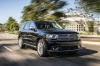 Picture of a driving 2017 Dodge Durango Citadel in Brilliant Black Crystal Pearlcoat from a front right three-quarter perspective