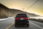 Picture of a driving 2017 Dodge Durango Citadel in Brilliant Black Crystal Pearlcoat from a rear perspective