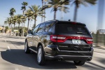 Picture of a driving 2017 Dodge Durango Citadel in Brilliant Black Crystal Pearlcoat from a rear left perspective