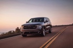 Picture of a driving 2017 Dodge Durango R/T in Maximum Steel Metallic Clearcoat from a front left perspective