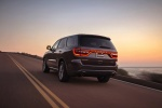Picture of a driving 2017 Dodge Durango R/T in Maximum Steel Metallic Clearcoat from a rear left three-quarter perspective