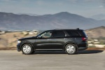Picture of a driving 2017 Dodge Durango Citadel in Brilliant Black Crystal Pearlcoat from a left side perspective