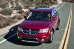 Picture of a driving 2019 Dodge Journey in Redline 2 Coat Pearl from a front left perspective
