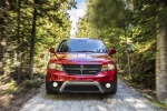 Picture of a driving 2019 Dodge Journey Crossroad AWD in Redline 2 Coat Pearl from a frontal perspective