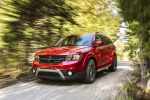 Picture of a driving 2019 Dodge Journey Crossroad AWD in Redline 2 Coat Pearl from a front left three-quarter perspective