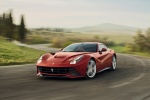 2013 Ferrari F12berlinetta in Rosso Scuderia - Driving Front Left View