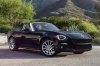 2017 Fiat 124 Spider in Nero Cinema Jet Black from a front right three-quarter view