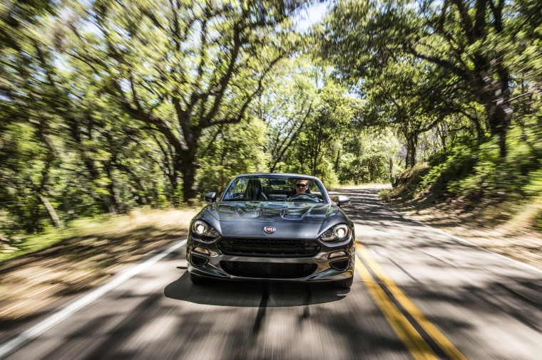 Driving 2018 Fiat 124 Spider in Grigio Moda Meteor Gray from a frontal view