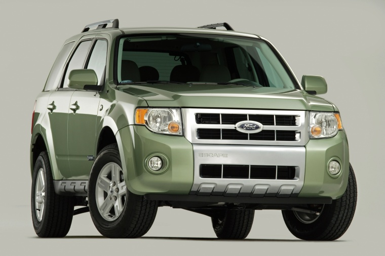 2012 Ford Escape Hybrid in Kiwi Green Metallic from a front right view