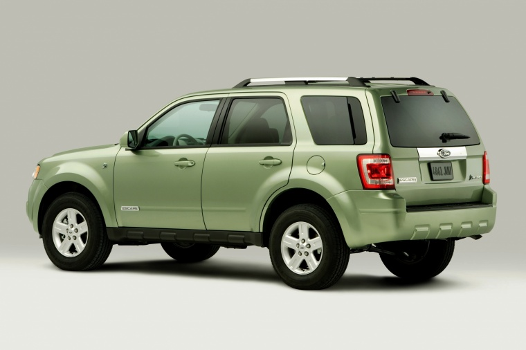 2012 Ford Escape Hybrid in Kiwi Green Metallic from a rear left three-quarter view