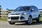 Picture of a 2014 Ford Escape Titanium 4WD in Ingot Silver Metallic from a front left perspective