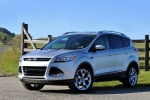 Picture of a 2014 Ford Escape Titanium 4WD in Ingot Silver Metallic from a front left three-quarter perspective